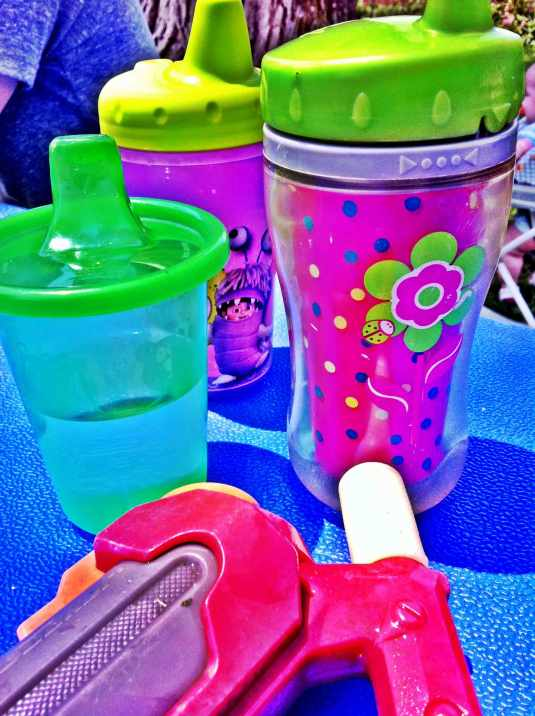 Day 19: Plastic My youngest grands sippy cups and a water gun!